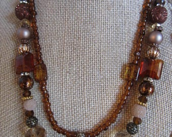 Lovely brown double strand necklace with silver accents.