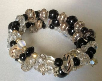 Black, Crystal and Lamp Work Beads on Silver Memory Wire Bracelet