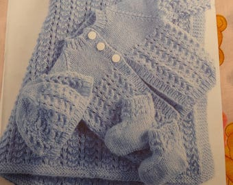 BABY BLUE LAYETTE,size 24 months, hand knitted ,sweater ,hat booties and blanket, elephant bottons, blanket 28 inches by 34 inches