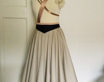 Vintage style Tea-Length Circle skirt in Dove grey with contrasting Navy waistband. Available in sizes XS-XL or made to measure.