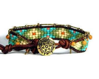 Bead Loom Bracelet Leather Wrap Bracelet Green Blue Coral Dangle Seed Bead Bracelet Coral Sun Charms Boho Bracelet Bohemian Jewelry
