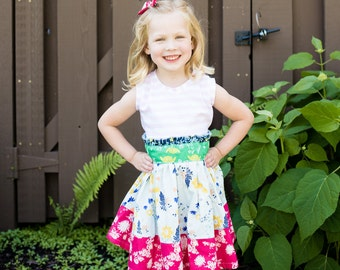 Girls ruffled sash  dress .     Available girls 6 months to 12 years.