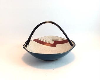 Vintage ceramic serving bowl in petroleum blue and off-white with modernist striped red and gold decor and black wire wrapped handle