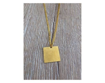 gold necklace with square pendant