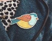 Free motion embroidery fabric bird brooch