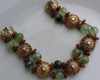 Vintage slide bracelet green beads and gold tone metal