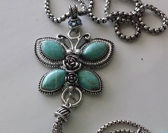 Handmade long necklace with butterfly pendant natural stones