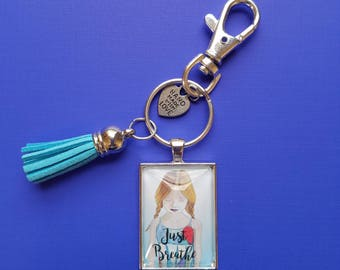 Just Breathe Pendant Keychain of wearble inspirational art print from original whimsical drawing of a girl in pigtails. Yoga Girl gift.