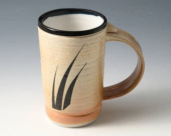 "Demi Mug - White Shino Glaze ""Three Grass"" design fired into the glaze. Holds 1-1/4 cups • Perfect desktop size."