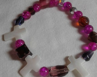 White cross, pink glass beads, with neutral glass beads bracelet