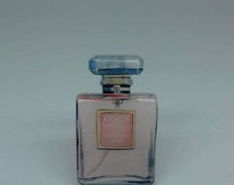 A classic Coco Chanel perfume bottle acrylic plastic brooch pin