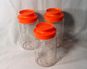 Set of 3 Clear Glass Lidded Storage Jars, Orange Plastic Lids - Anchor Hocking Clear Glass with Picture - Light House, Church, Bridge