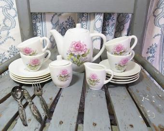 Vintage Child's Pink Rose Tea set Play miniature dishes - Tea Pot, Cream and Sugar, 4 tea cups, 8 plates & Plastic Silverware (discolored)