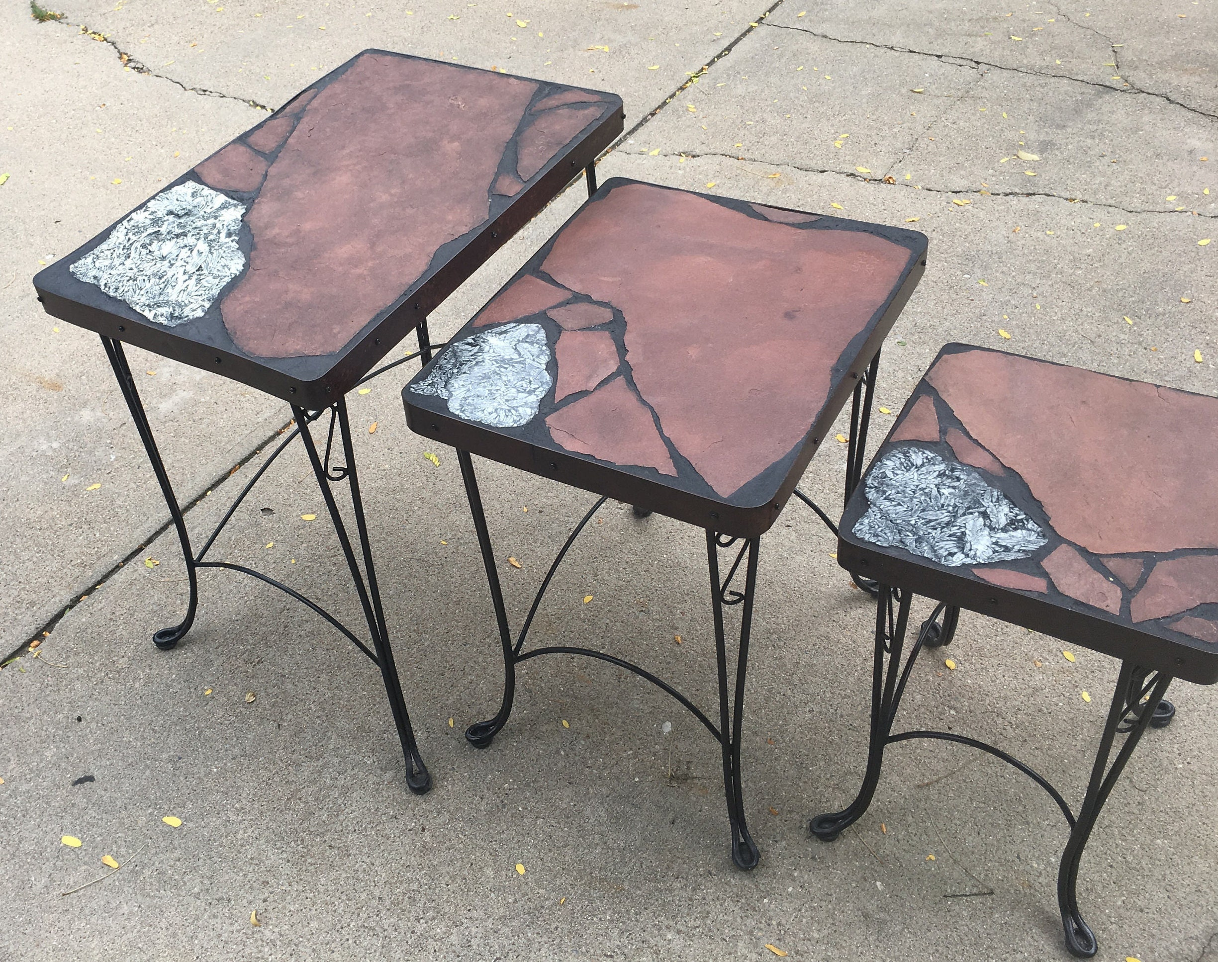 Pinolyth Stack A set of three netural stone folk art tables on