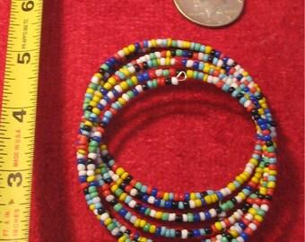 Multi colored beaded stiff wire breaded bracelet.