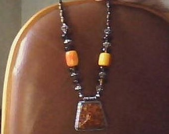 Amber necklace with orange colored stones.