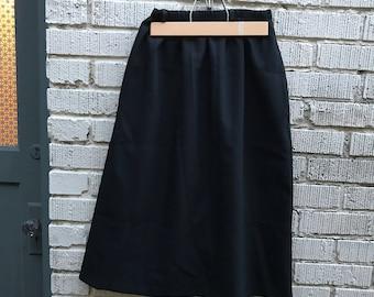 80s Black A-Line Skirt. 1980s. Medium. Polyester