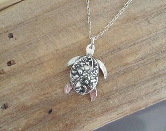 Handmade fine silver turtle charm pendant on sterling silver necklace.