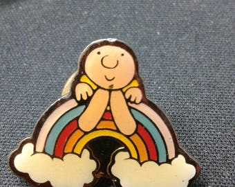 Little man sitting happily on a rainbow cloud pin brooch