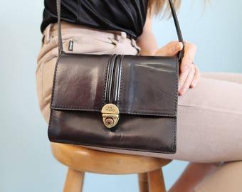 Vintage Black Leather Shoulder Bag with Gold Clasp