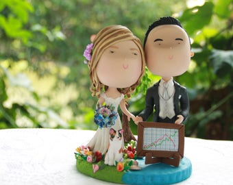 Couple holding hands - with clutter base, sea and grass and pet cat. Wedding caketopper. Wedding figurine. Handmade. Fully customizable.