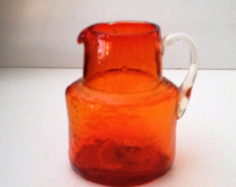 Pilgrim Glass Hand Blown Small Tangerine Oval Glass Pitcher with Applied Clear Glass Handle; New Condition Vintage
