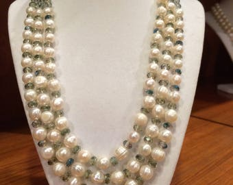 Fresh water pearls unique necklace with Swarovski crystals accent.