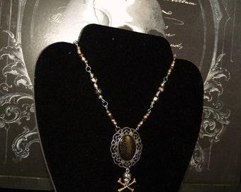 Golden skull and cross bones necklace