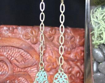 handmade hamsa hand dangle earring with patina