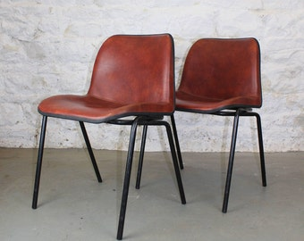 Vintage stackable leather chairs