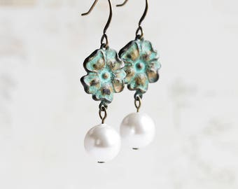 White Pearl Earrings with Green Patina Flower Dangles on Antiqued Brass Hooks