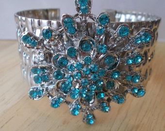 Silver Tone Cuff Bracelet with a Silver and Blue Rhinestone Brooch