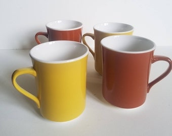 Syracuse China Syralite vintage coffee mugs - set of 4 total, mustard yellow and rust orange color mugs. Restaurant ware, retro kitchen.