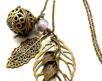 A scent! Necklace has perfume leaf, violet flower Pearl spun charms and co.