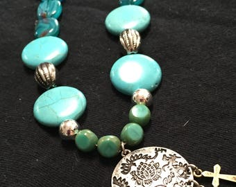 Turquoise and silver accented with various shades of blue glass beads