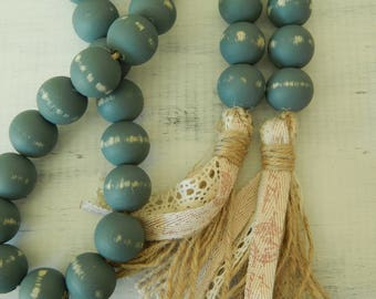 Chippy wood bead garland with double jute tassel, jewelry for the home, distressed wood, farmhouse beads, rustic decor, farmhouse blue