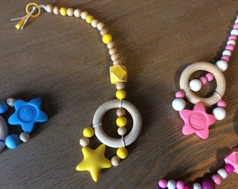 """rattle toy """"smile"""", quiet and teething and/or pacifier."""