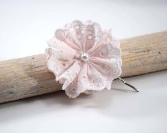 Pink eyelet flower on hair clip