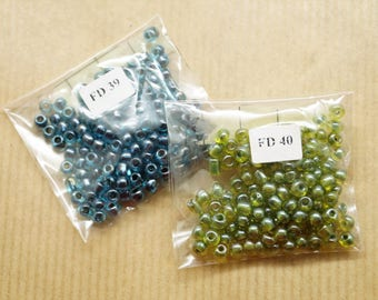 2 bags of 115 seed beads each, glass, 4 mm