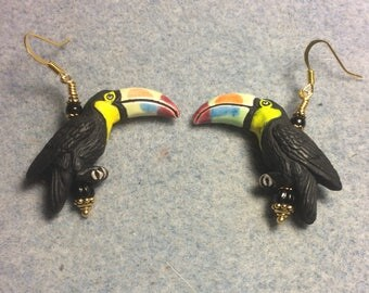 Black (with colorful beaks) ceramic toucan bead earrings adorned with black Czech glass beads.