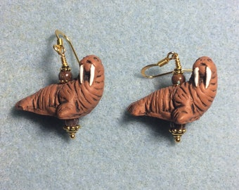 Brown ceramic walrus bead earrings adorned with brown Czech glass beads.