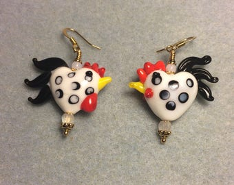 White with black spots heart shaped lampwork rooster bead earrings adorned with clear Czech glass beads.
