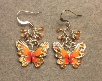 Orange and peach enamel and rhinestone butterfly charm earrings adorned with tiny dangling orange Chinese crystal beads.