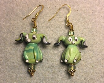 Opaque light green floppy eared lampwork puppy dog bead earrings adorned with light green Czech glass beads.