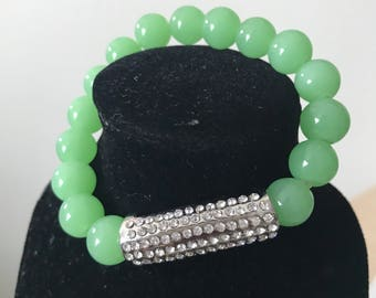 Light green beaded bracelet with silver sparkle connector