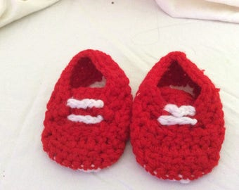 Red booties in tennis shoe style for a baby 0-3 mo.