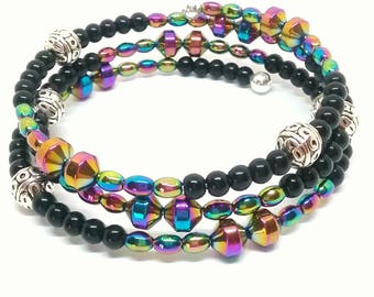 Black and rainbow hemalyke beaded memory wire wrap bracelet.