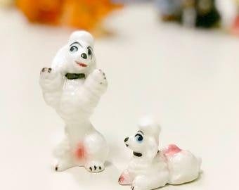 Mid-century 1950s white poodle minature ceramic figuirines. Made in Japan.