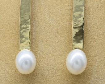 Drop-shaped White freshwater pearl earrings with 18k yellow gold hammered accent on french wires