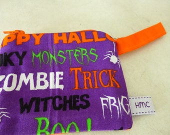 Mini zippered bag.  Trick or Treat. 11cm  x 9cm. Orange swirl back. Fully lined. Washable. Ideal for coins, lipstick,etc.